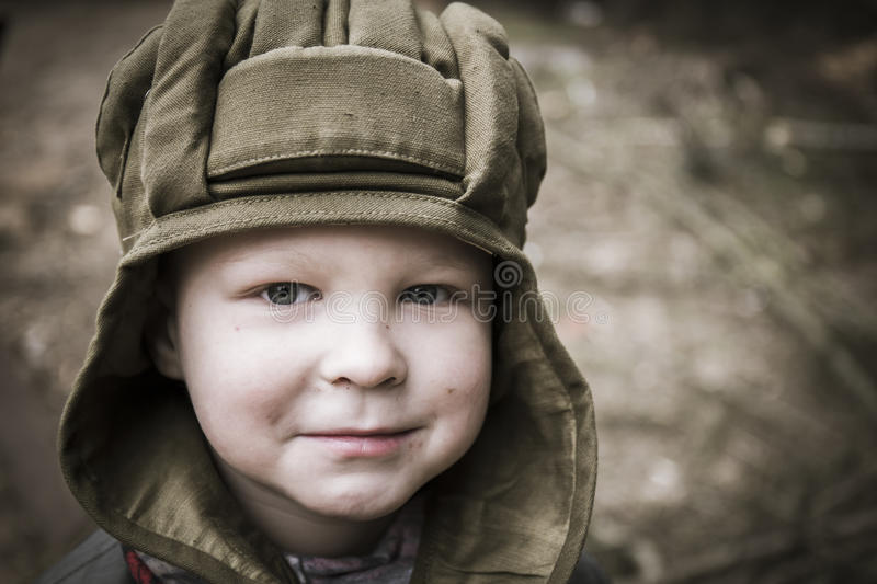 Little boy in a tank helmet royalty free stock image