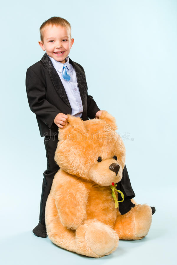 Download Little boy and teddy bear stock photo. Image of people - 33950026