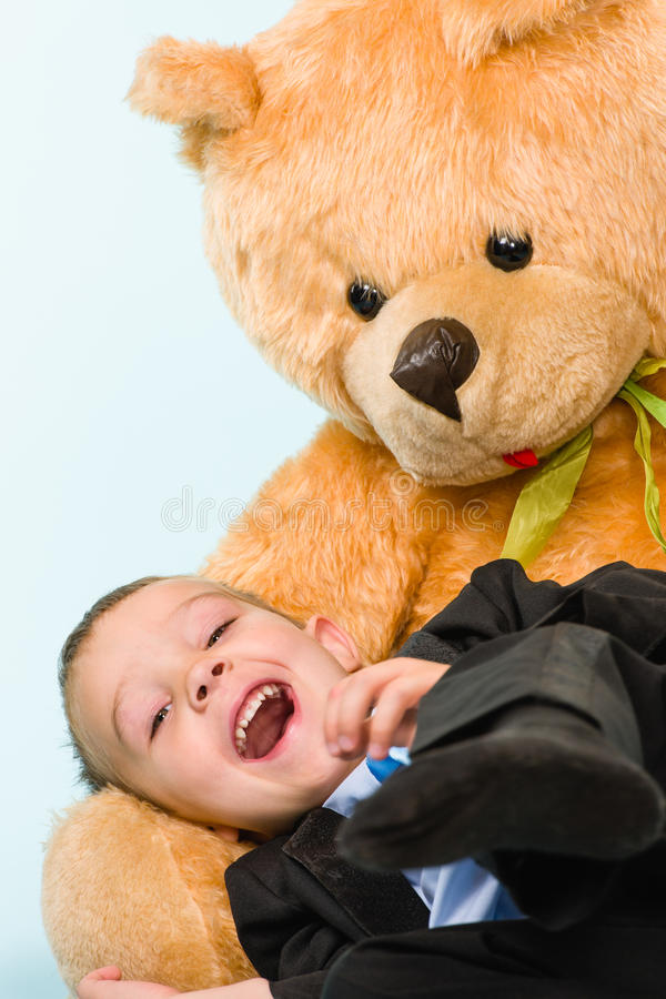Download Little boy and teddy bear stock image. Image of light - 33950093