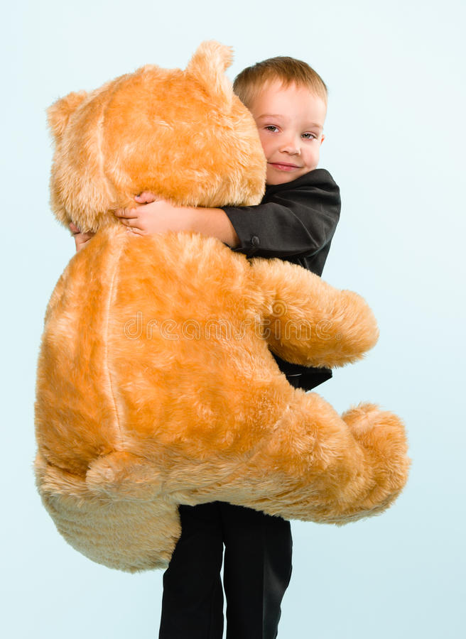 Download Little Boy And Teddy Bear Royalty Free Stock Photo - Image: 33950125