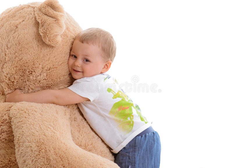 Little boy with teddy stock images