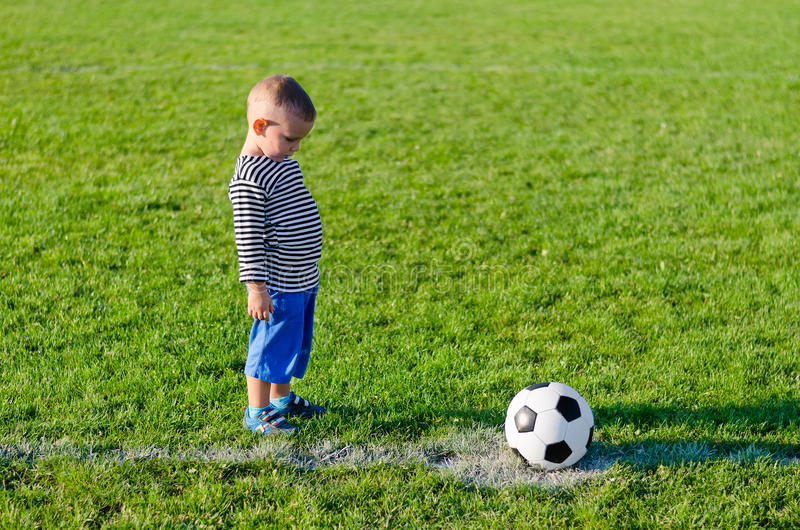 Little boy about to kick a soccer stock image