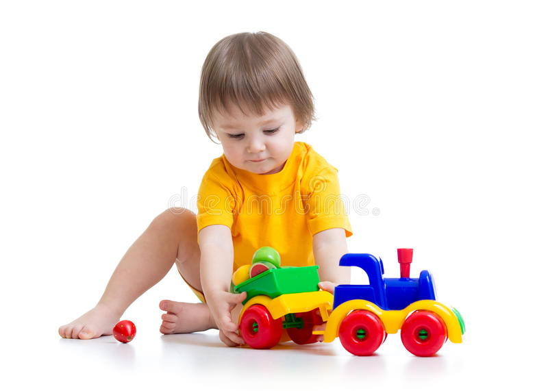 Little boy toddler playing with toy. Little boy kid playing with car toy isolated stock photo
