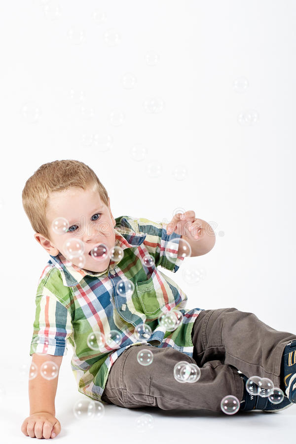 Little Boy Touching Bubbles Royalty Free Stock Photography