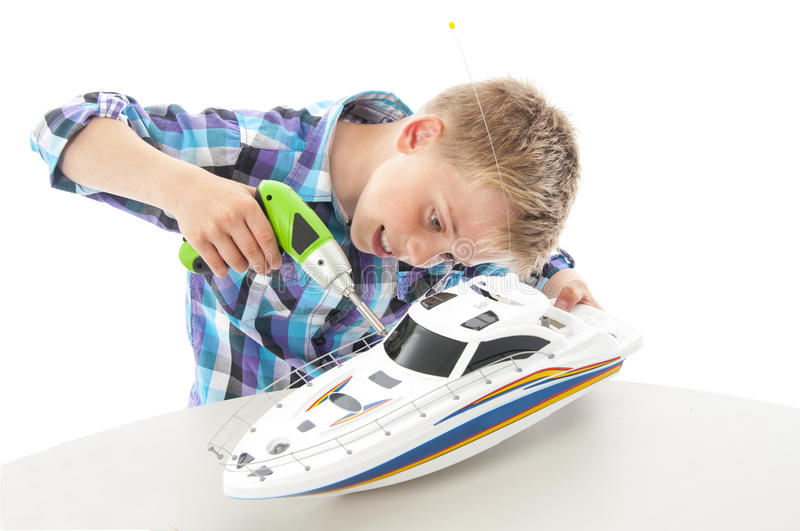 Little boy with toy boat stock image