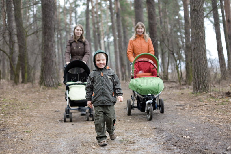 Download Little Boy And Two Mums With Carriages Stock Image - Image: 8876007