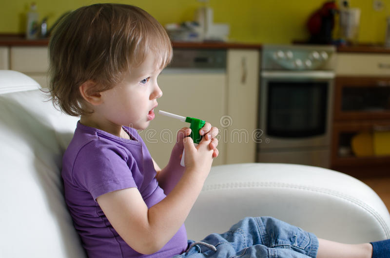 Little boy using inhaler royalty free stock photos