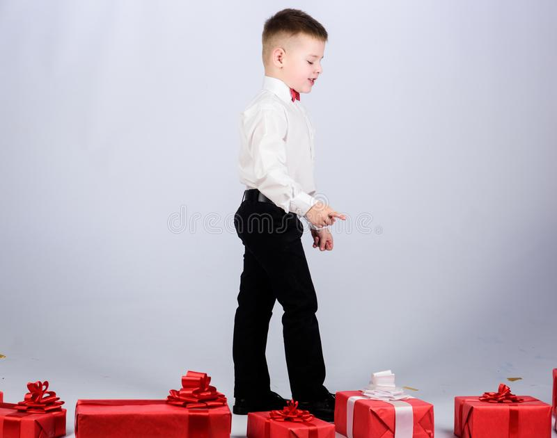 Little boy with valentines day gift. tuxedo style. Happy childhood. Birthday party. happy child with present box. Christmas. Shopping. Boxing day. New year royalty free stock photo