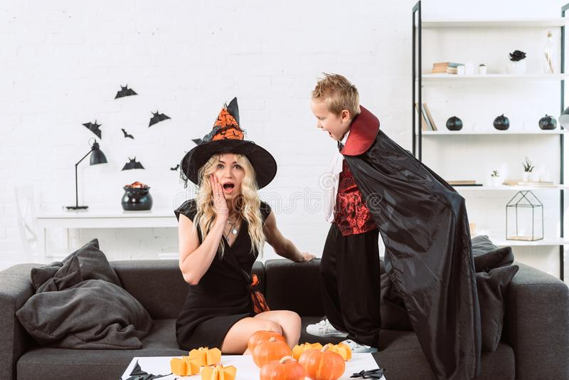little boy in vampire costume screaming at mother in witch halloween costume royalty free stock photos