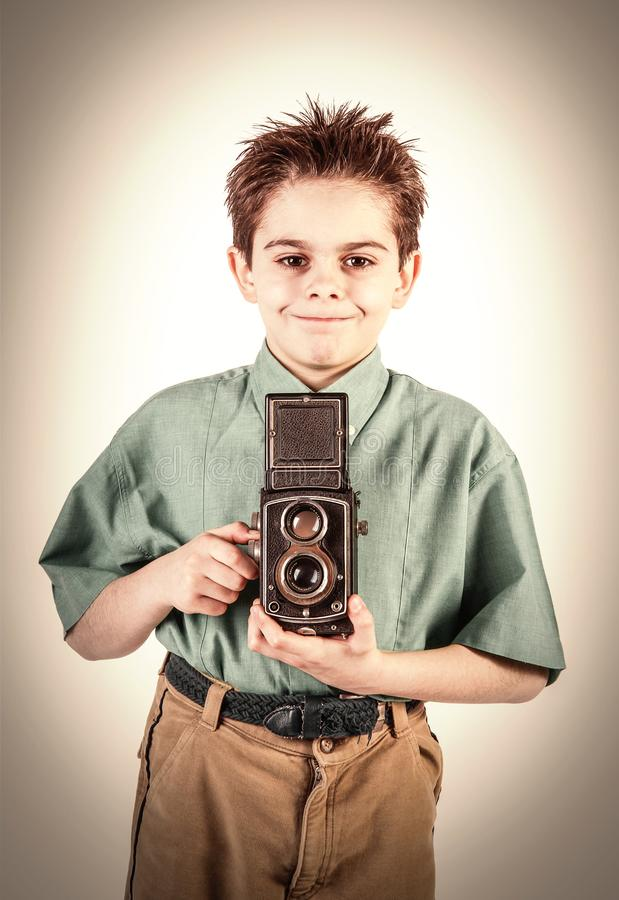 Little boy with a vintage camera royalty free stock photography