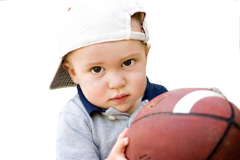 Little Boy voulant jouer au football photos libres de droits