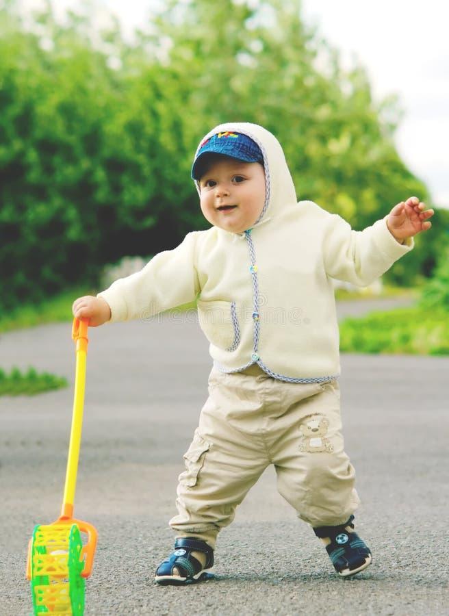 Little boy is walking along the street stock photography