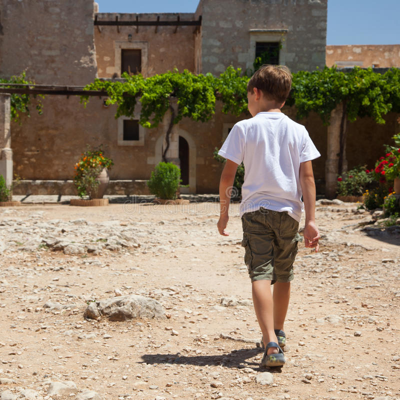 Download Little Boy Walkking To The Monastery Stock Image - Image: 26849151