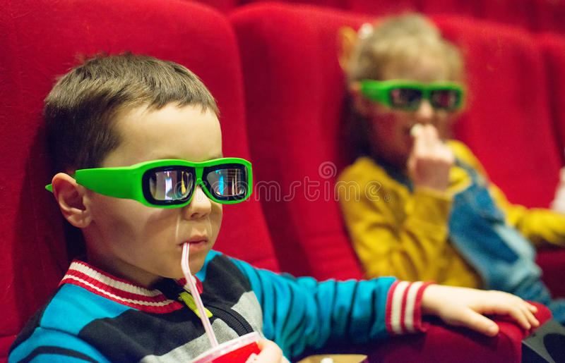 Little boy watching movie. royalty free stock images