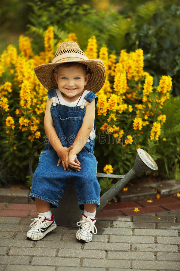 Free Little Boy Watering Flowers Stock Images - 33547794