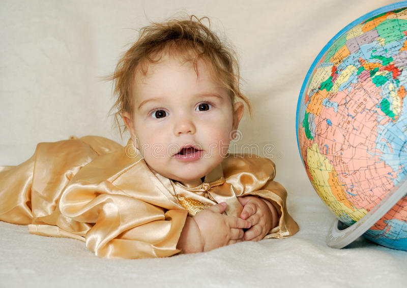 Download Little Boy Wearing Chinese Garment Next To Globe Royalty Free Stock Images - Image: 17570959