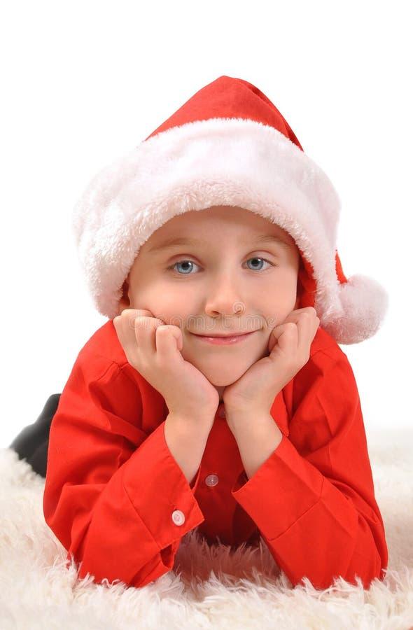 Little Boy Wearing Christmas Santa Hat stock photos