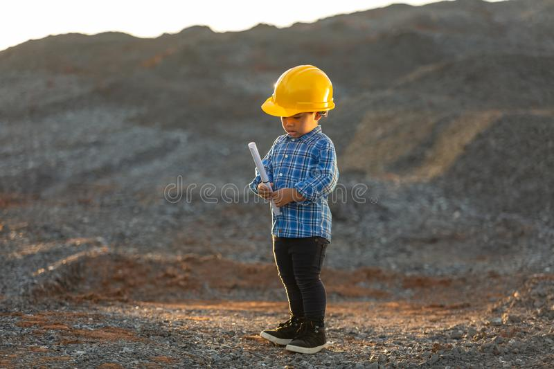 Little boy wearing a helmet, dream concept, want to be a future stock photography