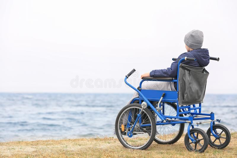 Little boy in wheelchair royalty free stock image