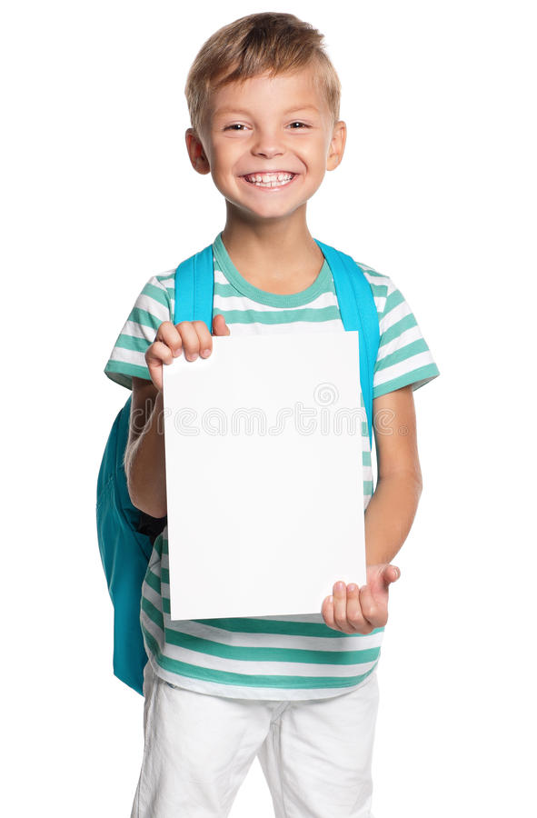 Little boy with white blank. Portrait of happy schoolboy with white blank isolated on white background stock photos