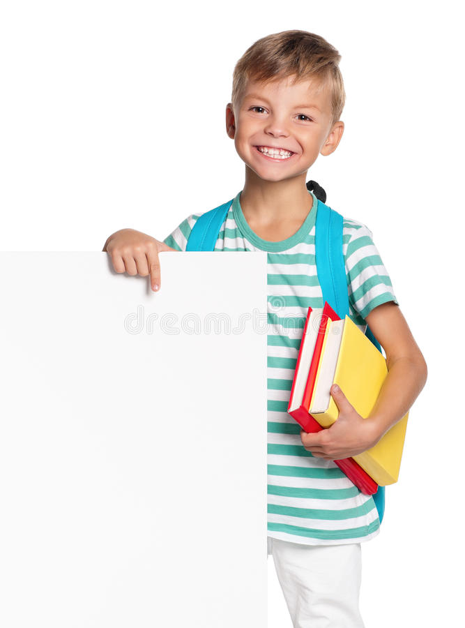 Little boy with white blank. Portrait of happy schoolboy with white blank isolated on white background royalty free stock images
