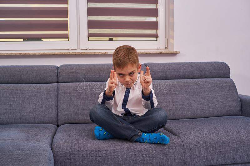 The little boy is concentrated royalty free stock photography