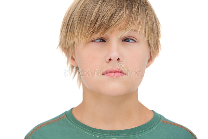 Little boy wincing. On white background stock photography