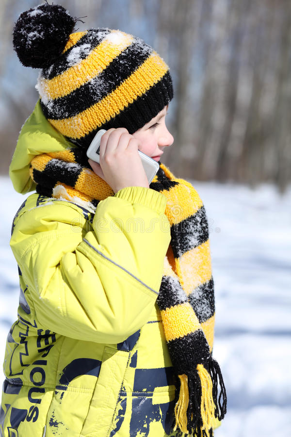 Little boy in a winter park stock photo