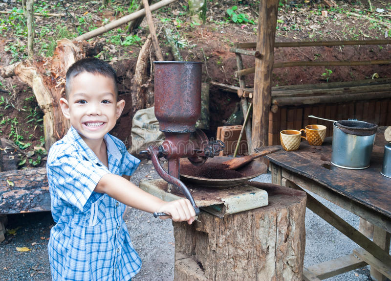 Little boy withVintage coffee mill grinder royalty free stock photography