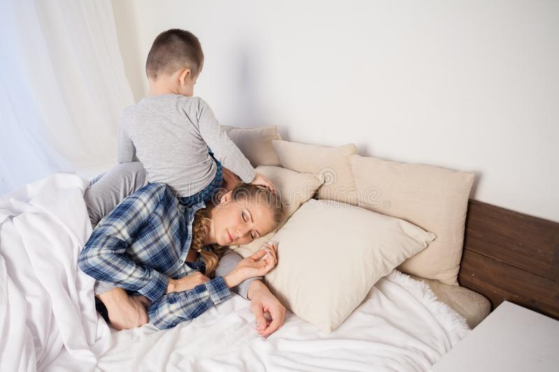 Little boy woke the parents in the bedroom royalty free stock image