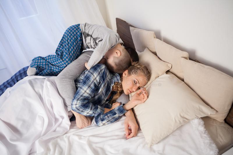 Little boy woke up in the morning sleeping in parents bedroom stock image