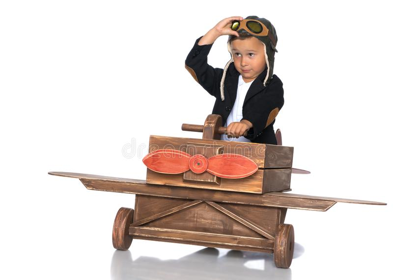 Little boy with a wooden plane. stock photography