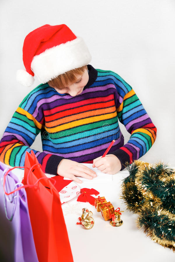 Little boy writes the letter to Santa Claus