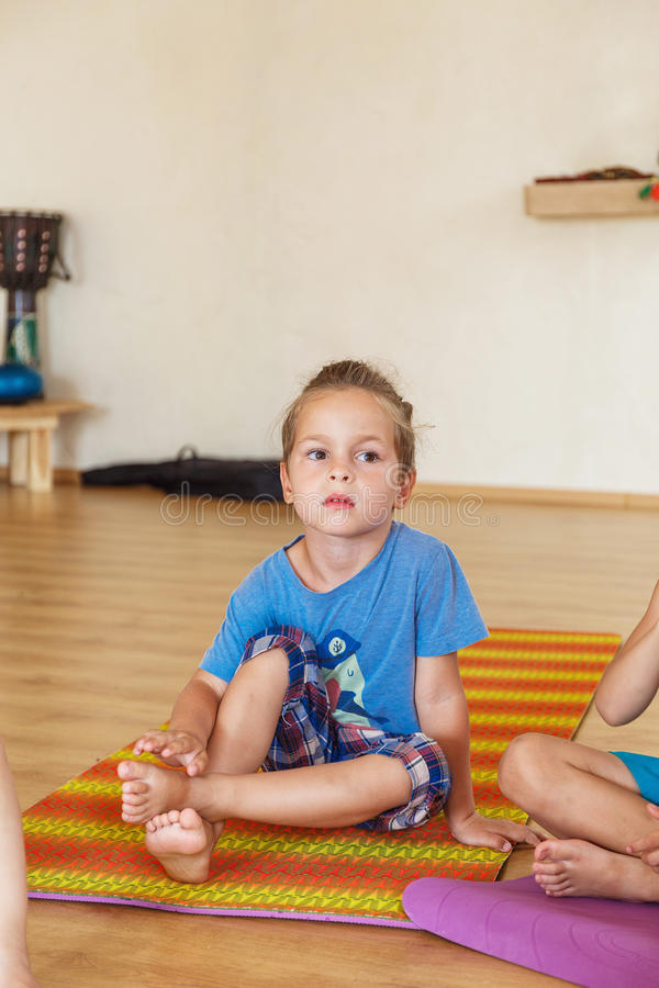 Download Little boy on a yoga class stock photo. Image of arms - 83719406