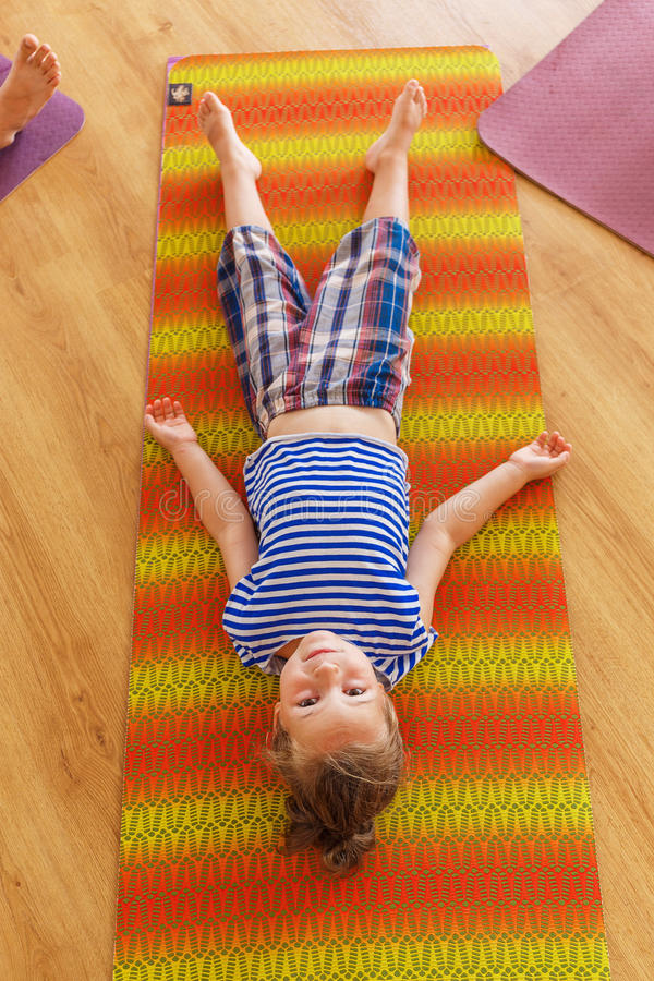 Download Little boy on a yoga class stock photo. Image of emotion - 83719712