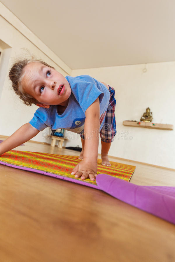 Download Little boy on a yoga class stock image. Image of fitness - 83719945