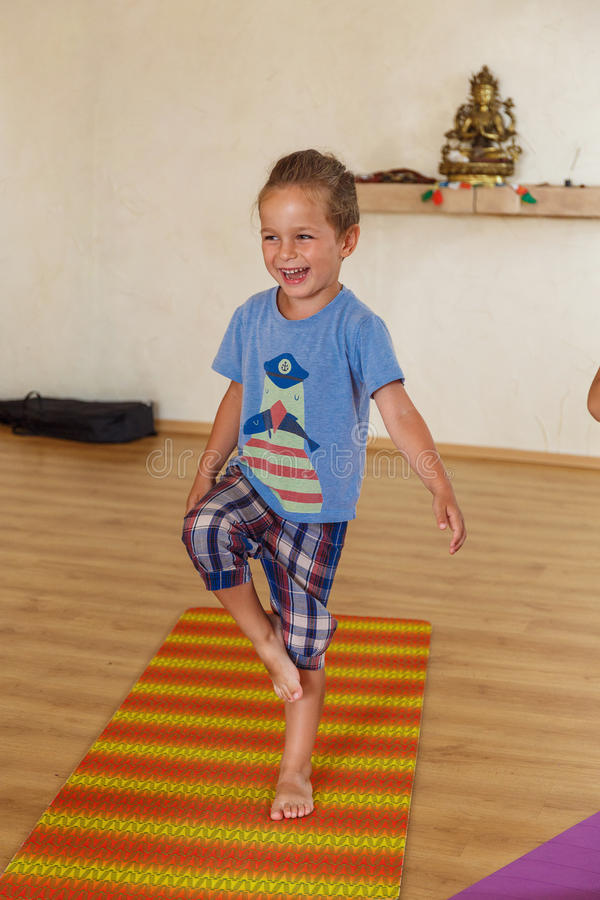 Download Little boy on a yoga class stock photo. Image of asana - 83720112