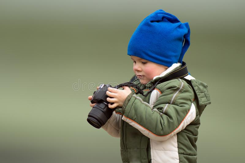 Little boy young photographer stock photography