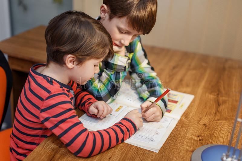 Little boys doing math homework stock photos