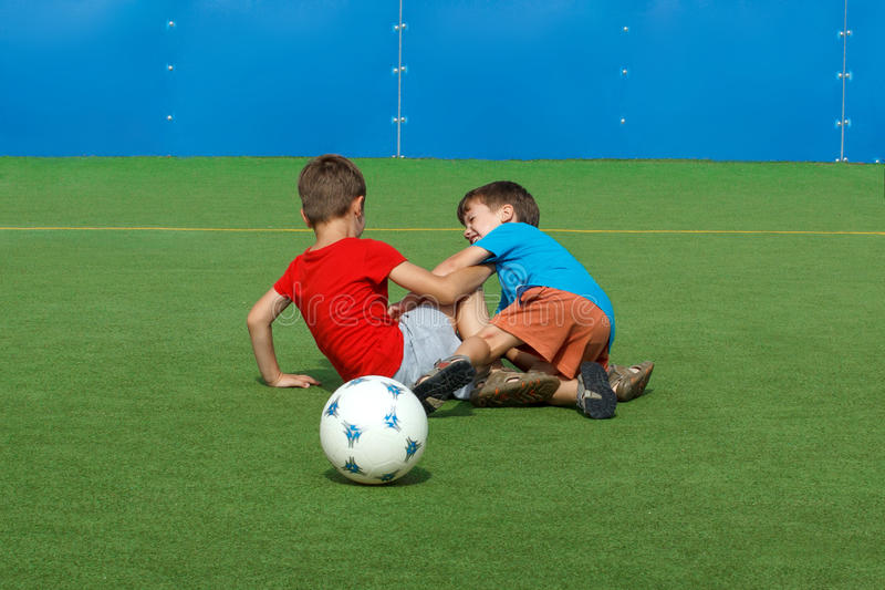 Little boys fault on soccer field. Fight royalty free stock photography