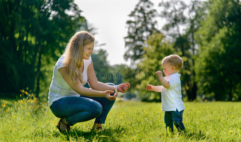 Little boys first steps stock photo