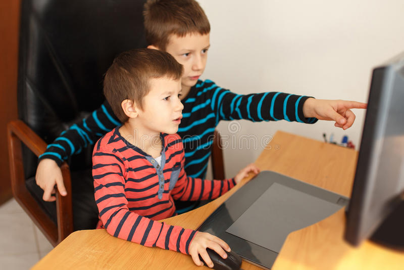 Little boys learning at computer stock image