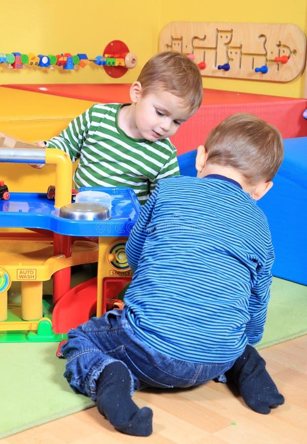 Little boys playing in kindergarten stock photos