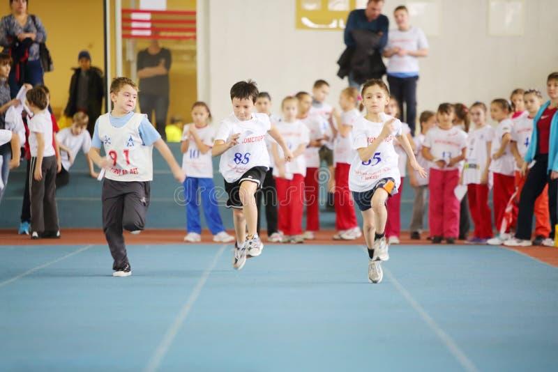Little boys run in stadium at children competition. MOSCOW - DEC 1: Little boys run in stadium at children competition under auspices of MOSCOMSPORT in Physical royalty free stock photo
