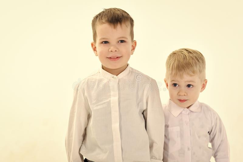 Little boys in white shirt, business. Happy family, values, brothers. Kid fashion, style and look, boss baby. Childhood and happiness, little boys. Children royalty free stock photo