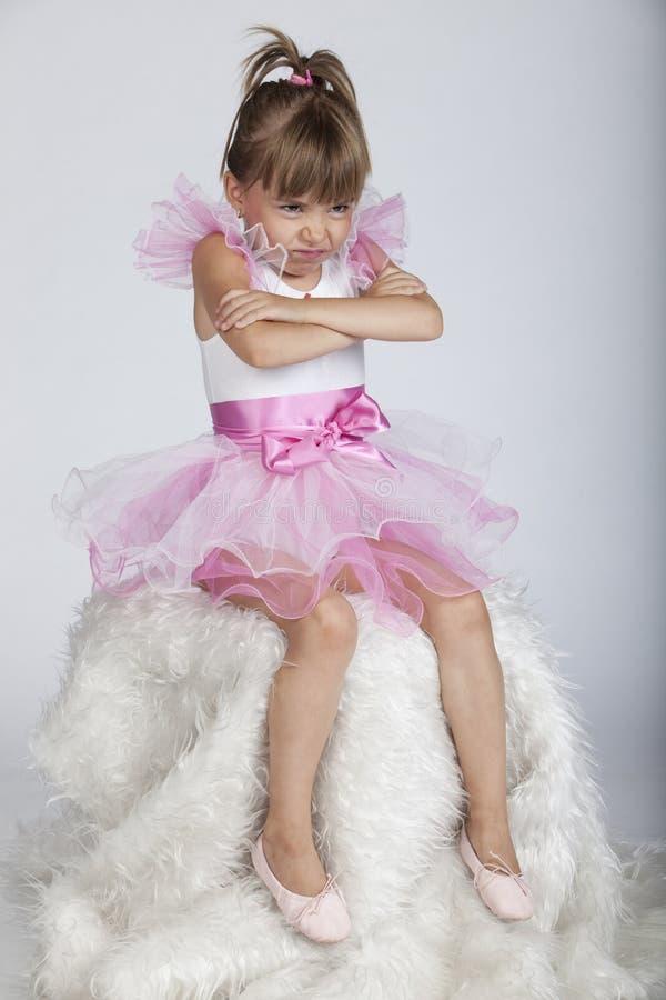 Little brat ballerina holding her arms crossed stock photos