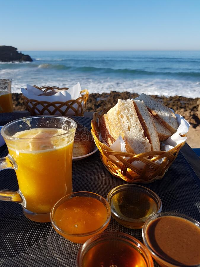 A little breakfast in front of the ocean stock images