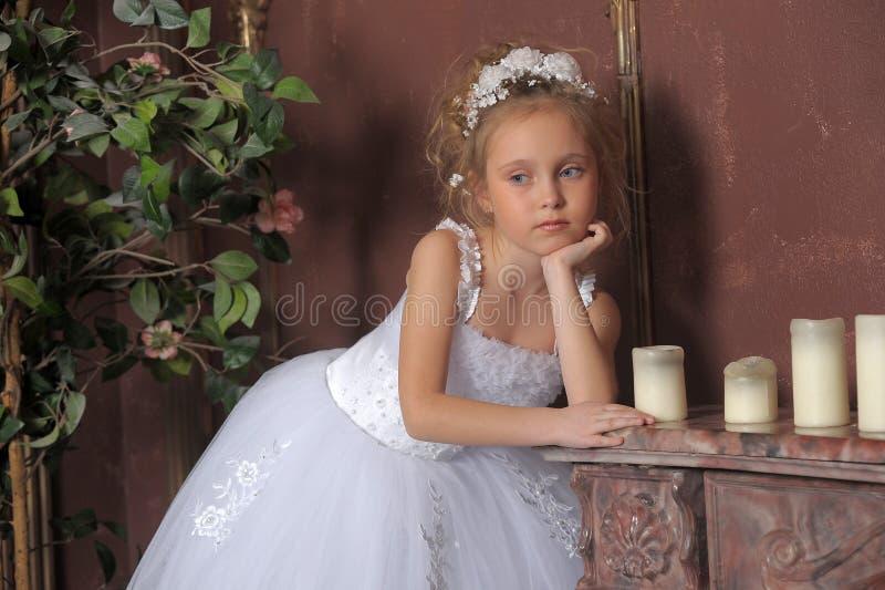 Little bride. Little girl in wedding dress royalty free stock photo