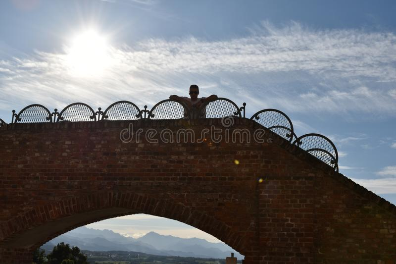 Little bridge with a person royalty free stock photo