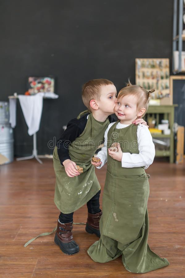 Little brother kissing his pretty sister stock photo